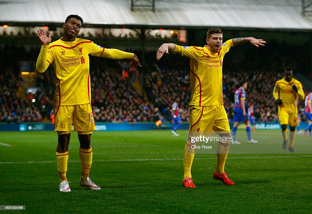 Daniel Sturridge of Liverpool (L) celebrates scoring their first goal with Alberto Moreno of Liverpool during the FA Cup fifth round match between Crystal Palace and Liverpool at Selhurst Park on February 14, 2015 in London, England.