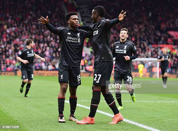 Daniel Sturridge of Liverpool celebrates with Divock Origi as he scores their second goal during the Barclays Premier League match between...