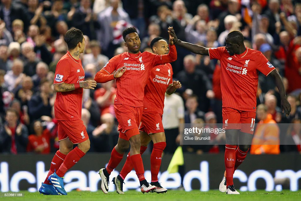 Daniel Sturridge of Liverpool celebrates with Mamadou Sakho of Liverpool after scoring his sides third goal during the Barclays Premier League match between Liverpool and Everton at Anfield, April 20, 2016, Liverpool, England
