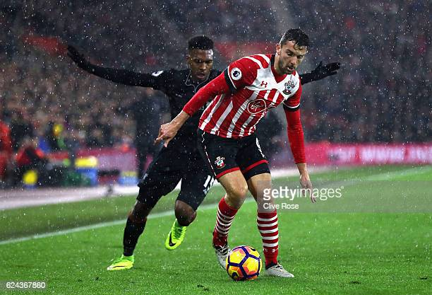 Daniel Sturridge of Liverpool chases Jay Rodriguez of Southampton during the Premier League match between Southampton and Liverpool at St Mary's...