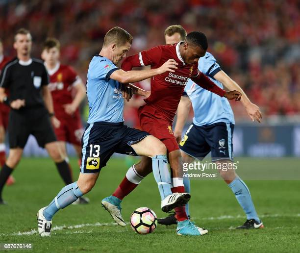 Daniel Sturridge of Liverpool competes with Brandon O'Neill of Sydney FC during the International Friendly match between Sydney FC and Liverpool FC...