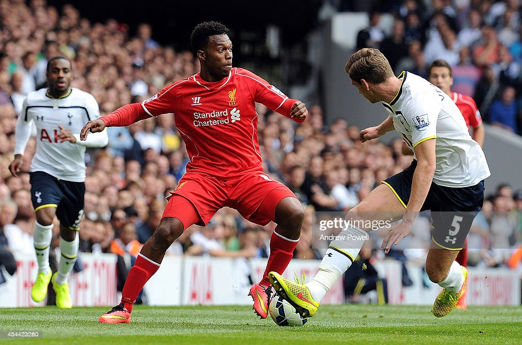 Daniel Sturridge of Liverpool competes with Jan Vertonghen of Tottenham Hotspur during the Barclays Premier League match between Tottenham Hotspur and Liverpool at White Hart Lane on August 31, 2014 in London, England.