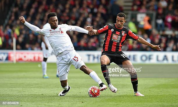 Daniel Sturridge of Liverpool competes with Junior Stanislas of AFC Bournemouth during the Barclays Premier League match between AFC Bournemouth and...