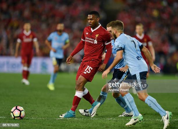 Daniel Sturridge of Liverpool competes with Michael Zullo of Sydney FC during the International Friendly match between Sydney FC and Liverpool FC at...