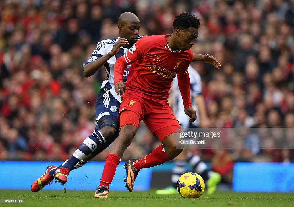 Daniel Sturridge of Liverpool competes with Youssouf Mulumbu of West Bromwich Albion on his way to scoring his team's fourth goal during the Barclays Premier League match between Liverpool and West Bromwich Albion at Anfield on October 26, 2013 in Liverpool, England.