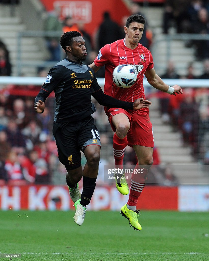 Daniel Sturridge of Liverpool goes up with Jose Fonte of Southampton during the Barclays Premier League match between Southampton and Liverpool at St Mary's Stadium on March 16, 2013 in Southampton, England.