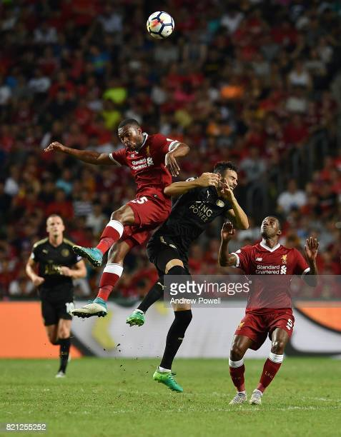 Daniel Sturridge of Liverpool goes up with Vicente Iborra of Leicester City during the Premier League Asia Trophy match between Liverpool FC and...