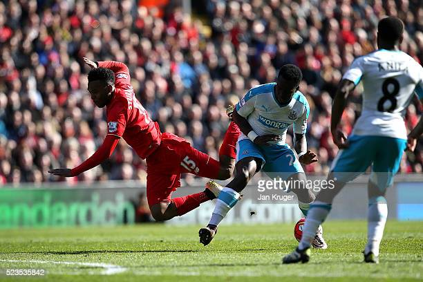 Daniel Sturridge of Liverpool is challenged by Cheick Tiote of Newcastle United during the Barclays Premier League match between Liverpool and...