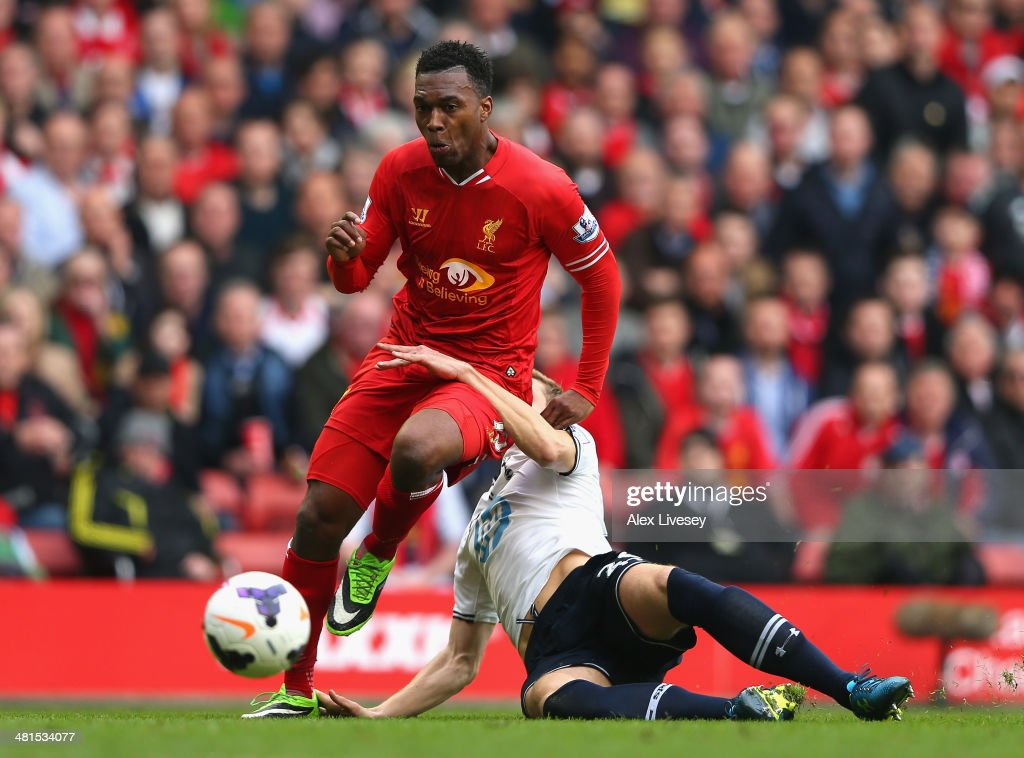 Daniel Sturridge of Liverpool is challenged by Michael Dawson of Tottenham Hotspur during the Barclays Premier League match between Liverpool and Tottenham Hotspur at Anfield on March 30, 2014 in Liverpool, England.