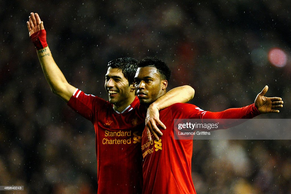 Daniel Sturridge (R) of Liverpool is congratulated by teammate Luis Suarez (L) after scoring his team's third goal during the Barclays Premier League match between Liverpool and Everton at Anfield on January 28, 2014 in Liverpool, England.