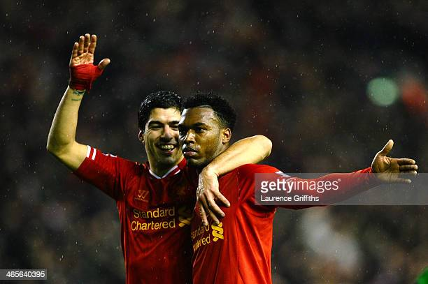 Daniel Sturridge of Liverpool is congratulated by teammate Luis Suarez after scoring his team's third goal during the Barclays Premier League match...