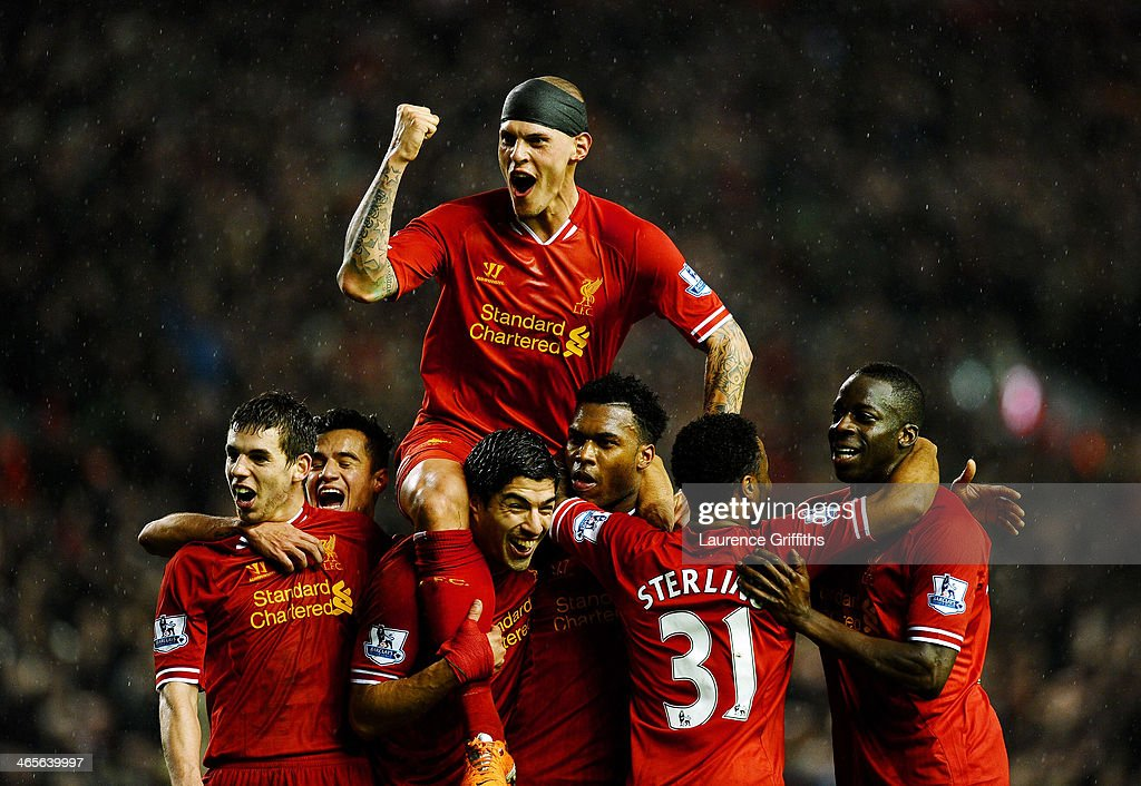 <a gi-track='captionPersonalityLinkClicked' href=/galleries/search?phrase=Daniel+Sturridge+-+Soccer+Player&family=editorial&specificpeople=677270 ng-click='$event.stopPropagation()'>Daniel Sturridge</a> (2nd R) of Liverpool is congratulated by teammates after scoring his team's third goal during the Barclays Premier League match between Liverpool and Everton at Anfield on January 28, 2014 in Liverpool, England.