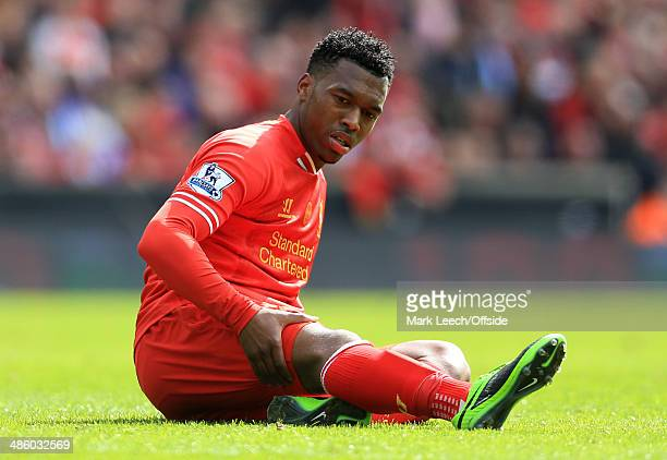 Daniel Sturridge of Liverpool lies injured holding his hamstring during the Barclays Premier League match between Liverpool and Manchester City at...