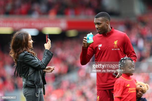 Daniel Sturridge of Liverpool on the pitch at full time with his family during the Premier League match between Liverpool and Middlesbrough at...