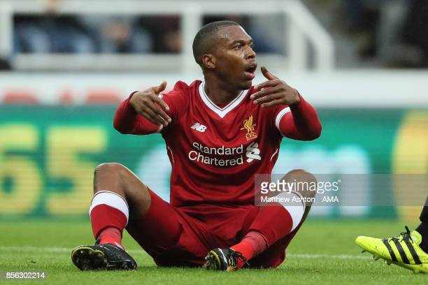 Daniel Sturridge of Liverpool reacts to a challenge during the Premier League match between Newcastle United and Liverpool at St James' Park on...