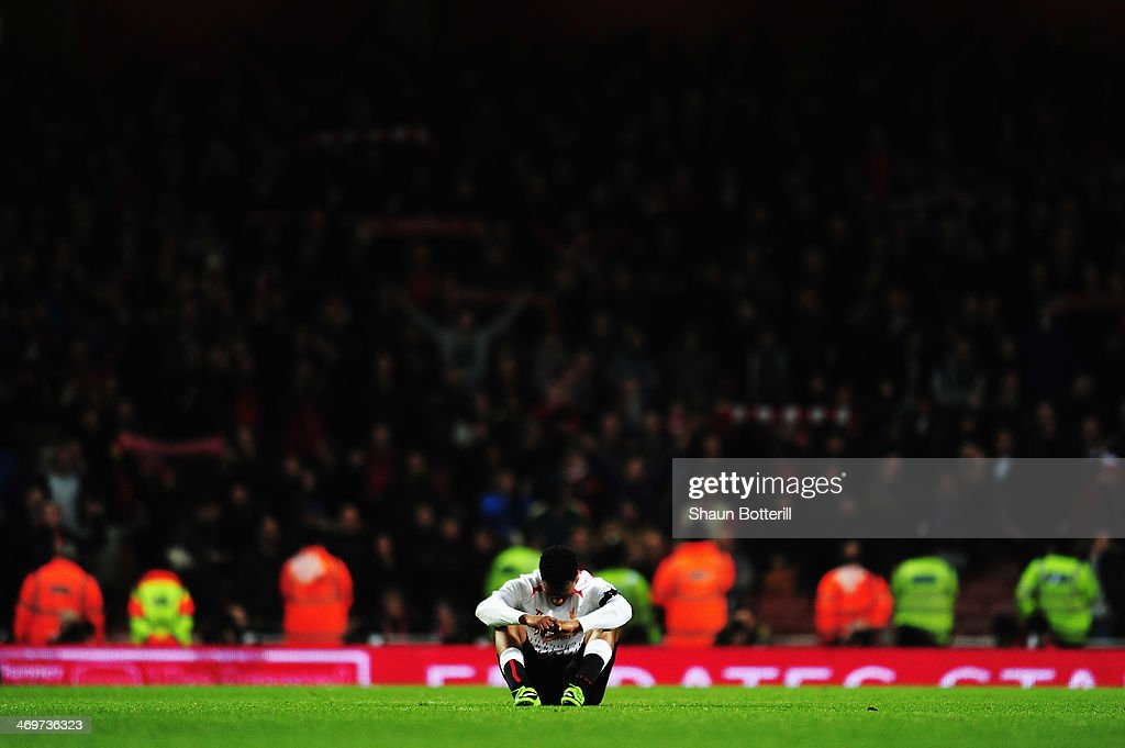 <a gi-track='captionPersonalityLinkClicked' href=/galleries/search?phrase=Daniel+Sturridge&family=editorial&specificpeople=677270 ng-click='$event.stopPropagation()'>Daniel Sturridge</a> of Liverpool reacts to defeat at the end of the FA Cup Fifth Round match between Arsenal and Liverpool at the Emirates Stadium on February 16, 2014 in London, England.