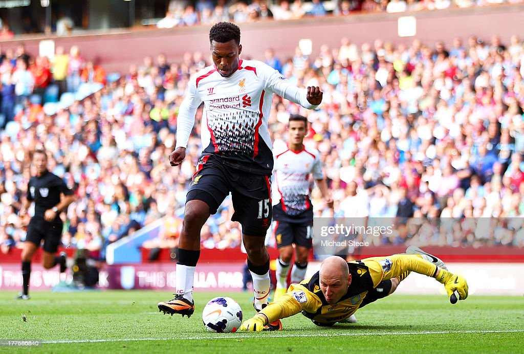 <a gi-track='captionPersonalityLinkClicked' href=/galleries/search?phrase=Daniel+Sturridge+-+Soccer+Player&family=editorial&specificpeople=677270 ng-click='$event.stopPropagation()'>Daniel Sturridge</a> of Liverpool rounds goalkeeper <a gi-track='captionPersonalityLinkClicked' href=/galleries/search?phrase=Brad+Guzan&family=editorial&specificpeople=662127 ng-click='$event.stopPropagation()'>Brad Guzan</a> of Aston Villa to score the opening goal during the Barclays Premier League match between Aston Villa and Liverpool at Villa Park on August 24, 2013 in Birmingham, England.