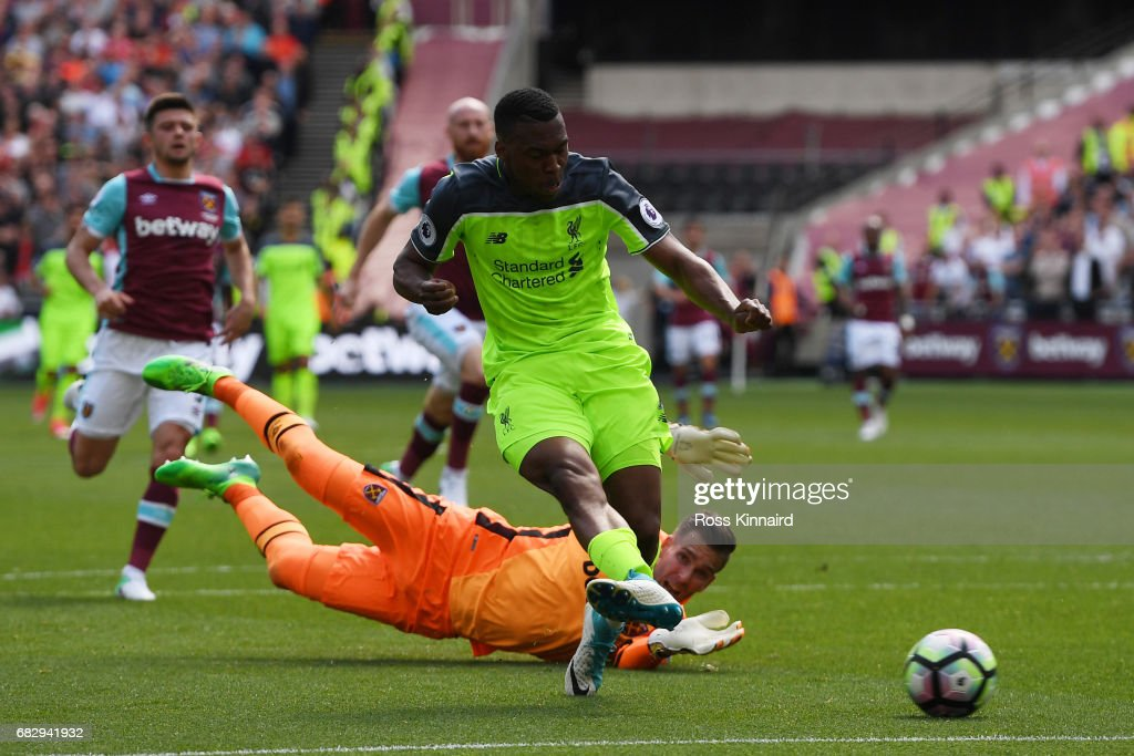 Daniel Sturridge of Liverpool scores his sides first goal by rounding Adrian of West Ham United during the Premier League match between West Ham United and Liverpool at London Stadium on May 14, 2017 in Stratford, England.
