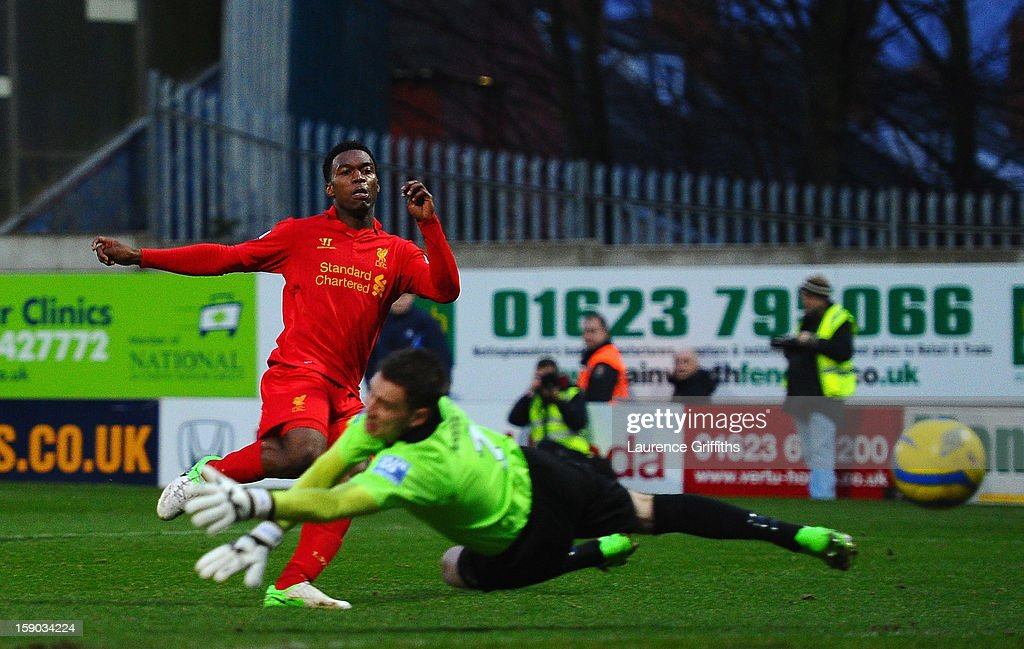 <a gi-track='captionPersonalityLinkClicked' href=/galleries/search?phrase=Daniel+Sturridge&family=editorial&specificpeople=677270 ng-click='$event.stopPropagation()'>Daniel Sturridge</a> of Liverpool scores past Alan Marriott of Mansfield Town during the FA Cup with Budweiser Third Round match between Mansfield Town and Liverpool at One Call Stadium on January 6, 2013 in Mansfield, England.