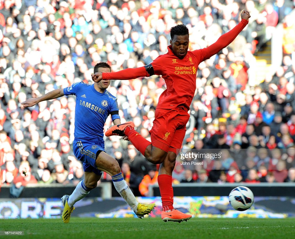 Daniel Sturridge of Liverpool scores the first Liverpool goal during the Barclays Premier League match between Liverpool and Chelsea at Anfield on April 21, 2013 in Liverpool, England.