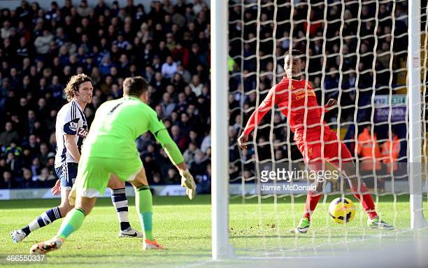 Daniel Sturridge of Liverpool scores the opening goal past goalkeeper Ben Foster of West Bromwich during the Barclays Premier League match between...
