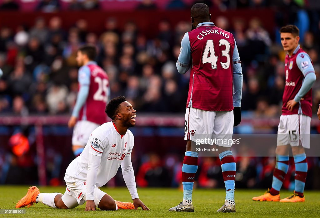<a gi-track='captionPersonalityLinkClicked' href=/galleries/search?phrase=Daniel+Sturridge&family=editorial&specificpeople=677270 ng-click='$event.stopPropagation()'>Daniel Sturridge</a> of Liverpool shares a joke with <a gi-track='captionPersonalityLinkClicked' href=/galleries/search?phrase=Aly+Cissokho&family=editorial&specificpeople=4302605 ng-click='$event.stopPropagation()'>Aly Cissokho</a> of Aston Villa as he stretches during the Barclays Premier League match between Aston Villa and Liverpool at Villa Park on February 14, 2016 in Birmingham, England.