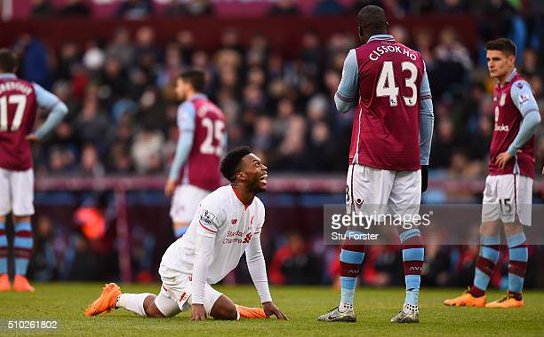 Daniel Sturridge of Liverpool shares a joke with Aly Cissokho of Aston Villa as he performs a yoga stretch during the Barclays Premier League match...