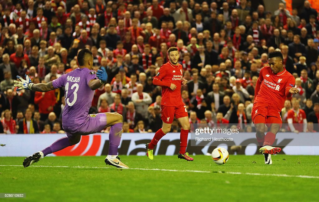 Daniel Sturridge of Liverpool (15) shoots past goalkeeper Alphonse Areola of Villarreal to score their second goal during the UEFA Europa League semi final second leg match between Liverpool and Villarreal CF at Anfield on May 5, 2016 in Liverpool, England.