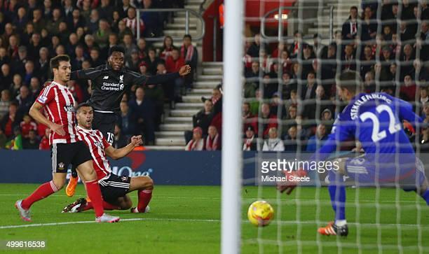 Daniel Sturridge of Liverpool shoots past goalkeeper Maarten Stekelenburg of Southampton to score their first goal during the Capital One Cup quarter...