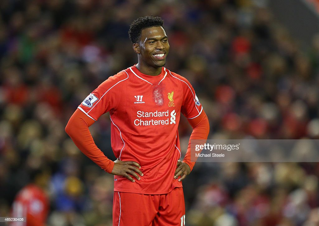 <a gi-track='captionPersonalityLinkClicked' href=/galleries/search?phrase=Daniel+Sturridge&family=editorial&specificpeople=677270 ng-click='$event.stopPropagation()'>Daniel Sturridge</a> of Liverpool smiles during the Barclays Premier League match between Liverpool and Burnley at Anfield on March 4, 2015 in Liverpool, England.