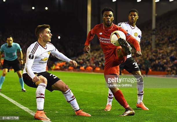 Daniel Sturridge of Liverpool takes on Guillermo Varela and Marcus Rashford of Manchester United during the UEFA Europa League Round of 16 first leg...