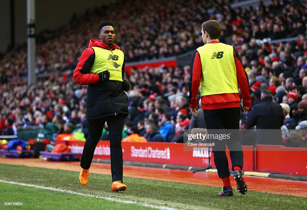 Daniel Sturridge (L) of Liverpool warms up during the Barclays Premier League match between Liverpool and Sunderland at Anfield on February 6, 2016 in Liverpool, England.