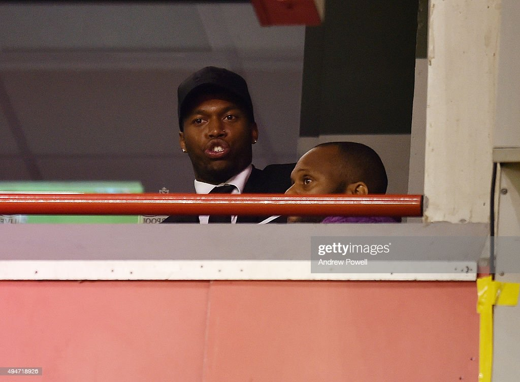 Daniel Sturridge of Liverpool watches from a box during the Capital One Cup Fourth Round match between Liverpool and AFC Bournemouth at Anfield on October 28, 2015 in Liverpool, England.