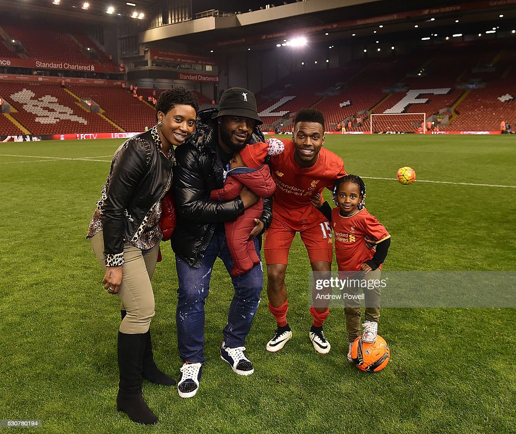 Daniel Sturridge of Liverpool with his family at the end of the Barclays Premier League match between Liverpool and Chelsea at Anfield on May 11, 2016 in Liverpool, England.