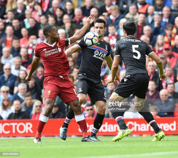 Daniel Sturridge of Liverpool with James Tomkins of Crystal Palace during the Premier League match between Liverpool and Crystal Palace at Anfield on...