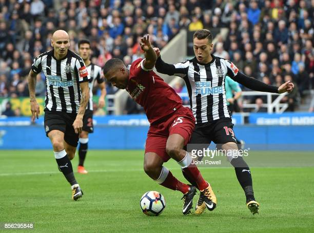 Daniel Sturridge of Liverpool with Javier Manquillo of Newcastle during the Premier League match between Newcastle United and Liverpool at St James...
