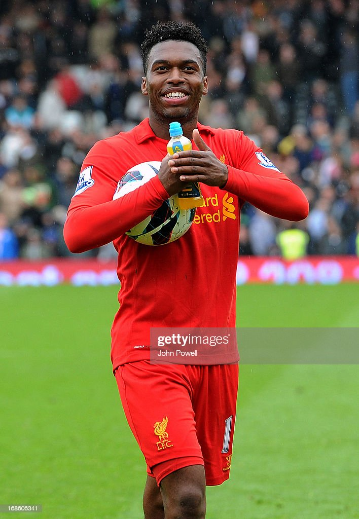 Daniel Sturridge of Liverpool with the hat-trick ball at the end of the Barclays Premier League Match between Fulham and Liverpool at Craven Cottage on May 12, 2013 in London, England.