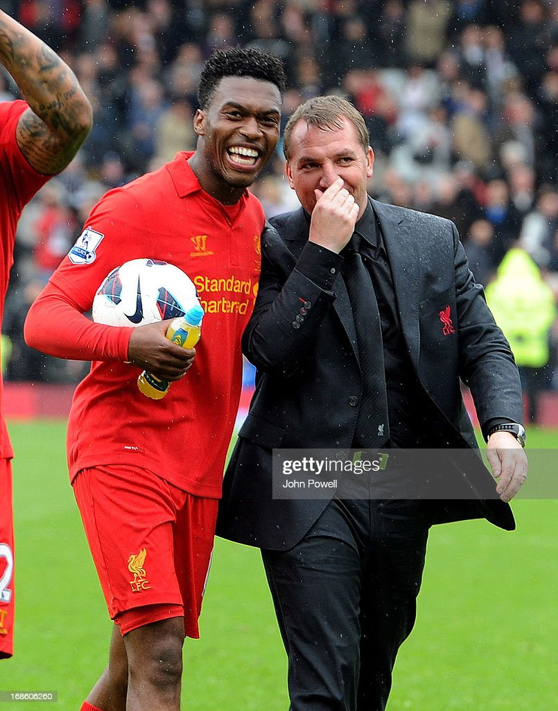 Daniel Sturridge of Liverpool with the hat-trick ball at the end with manager of Liverpool Brendan Rodgers of the Barclays Premier League Match between Fulham and Liverpool at Craven Cottage on May 12, 2013 in London, England.