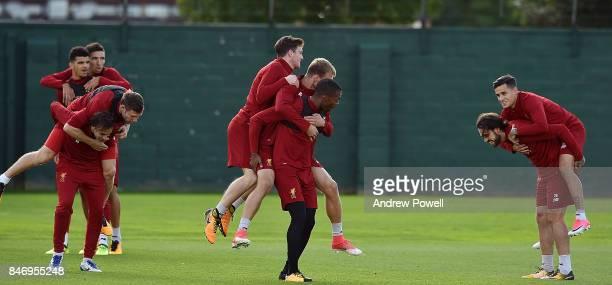 Daniel Sturridge Ragnar Klavan Andrew Robertson Danny Ings Philippe Coutinho Lazar Markovic and James Milner of Liverpool during a training session...