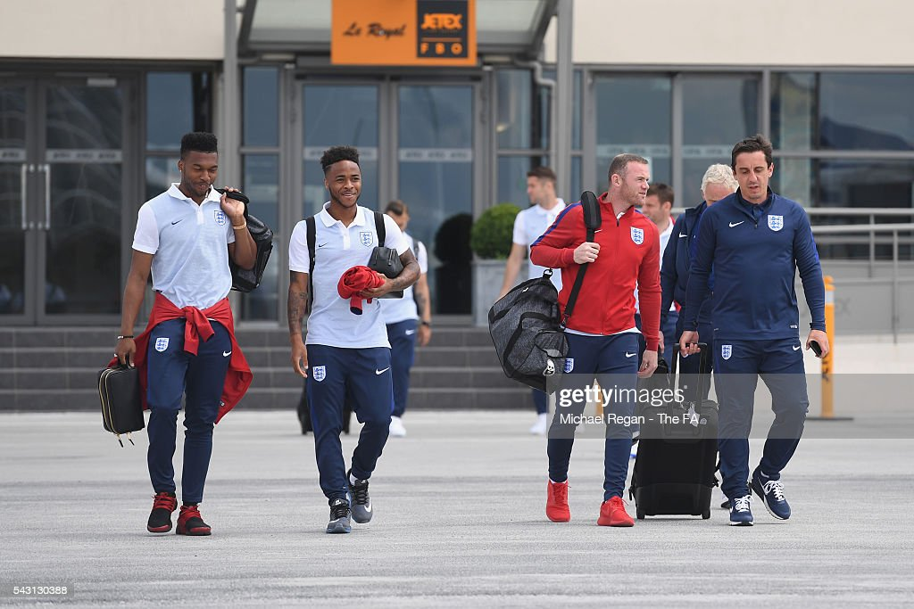<a gi-track='captionPersonalityLinkClicked' href=/galleries/search?phrase=Daniel+Sturridge+-+Soccer+Player&family=editorial&specificpeople=677270 ng-click='$event.stopPropagation()'>Daniel Sturridge</a>, <a gi-track='captionPersonalityLinkClicked' href=/galleries/search?phrase=Raheem+Sterling&family=editorial&specificpeople=6489439 ng-click='$event.stopPropagation()'>Raheem Sterling</a>, <a gi-track='captionPersonalityLinkClicked' href=/galleries/search?phrase=Wayne+Rooney&family=editorial&specificpeople=157598 ng-click='$event.stopPropagation()'>Wayne Rooney</a> and <a gi-track='captionPersonalityLinkClicked' href=/galleries/search?phrase=Gary+Neville&family=editorial&specificpeople=171409 ng-click='$event.stopPropagation()'>Gary Neville</a> look on as the England team board the flight to Nice on June 26, 2016 in Paris, France.