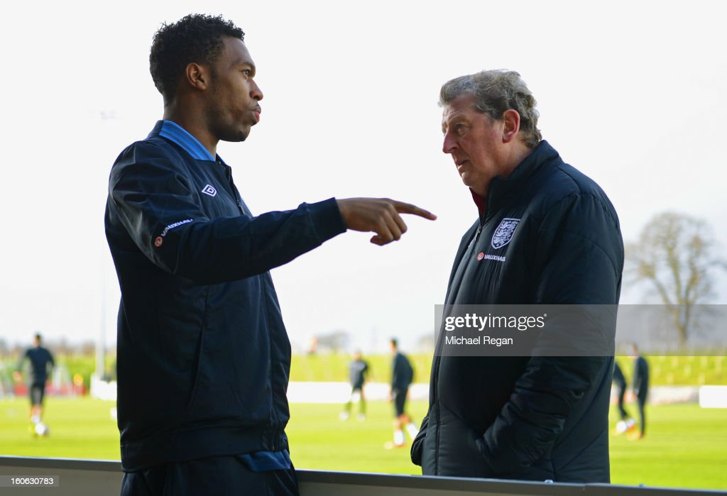 Daniel Sturridge speaks to manager Roy Hodgson during the Engand training session at St Georges Park on February 4, 2013 in Burton-upon-Trent, England.