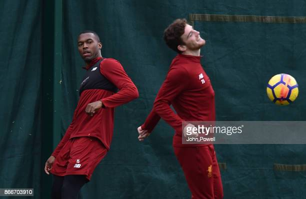 Daniel Sturridge with Andy Robertson of Liverpool during a training session at Melwood Training Ground on October 26 2017 in Liverpool England