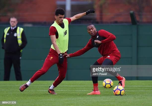 Daniel Sturridge with Dominic Solanke of Liverpool during a training session at Melwood Training Ground on November 2 2017 in Liverpool England