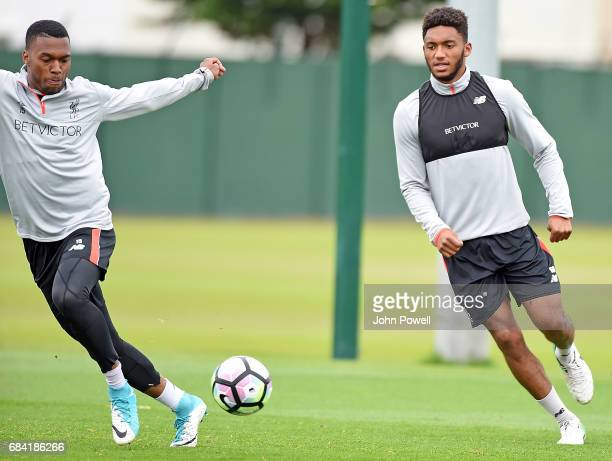 Daniel Sturridge with Joe Gomez of Liverpool during a training session at Melwood Training Ground on May 17 2017 in Liverpool England