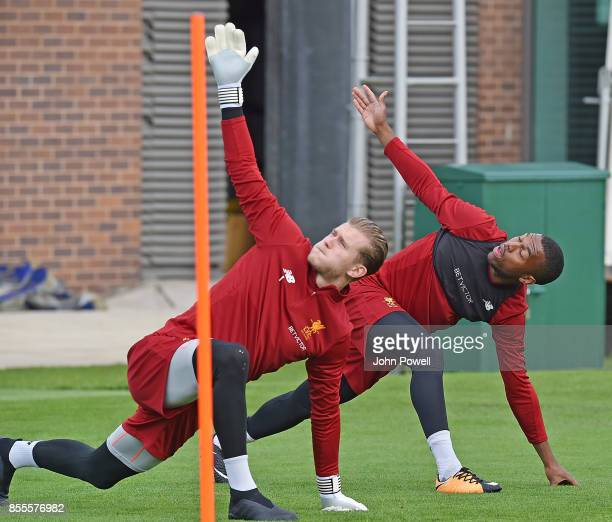 Daniel Sturridge with Loris Karius of Liverpool during training at Melwood Training Ground on September 29 2017 in Liverpool England