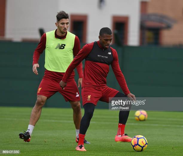 Daniel Sturridge with Marko Gujic of Liverpool during a training session at Melwood Training Ground on November 2 2017 in Liverpool England