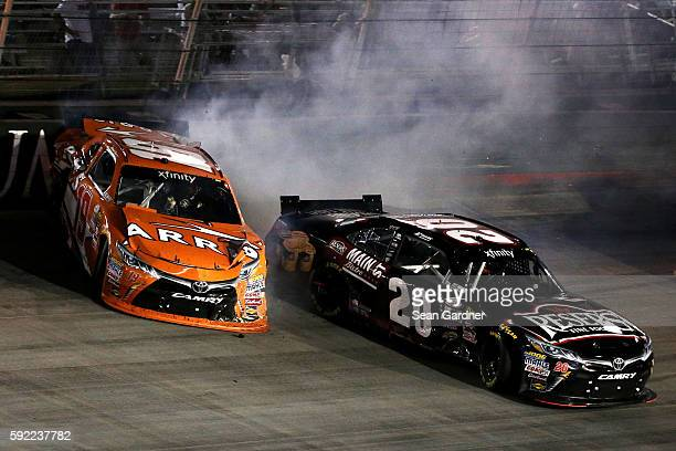 Daniel Suarez driver of the ARRIS Toyota and Erik Jones driver of the Resers Main Street Bistro Toyota have an on track incident during the NASCAR...