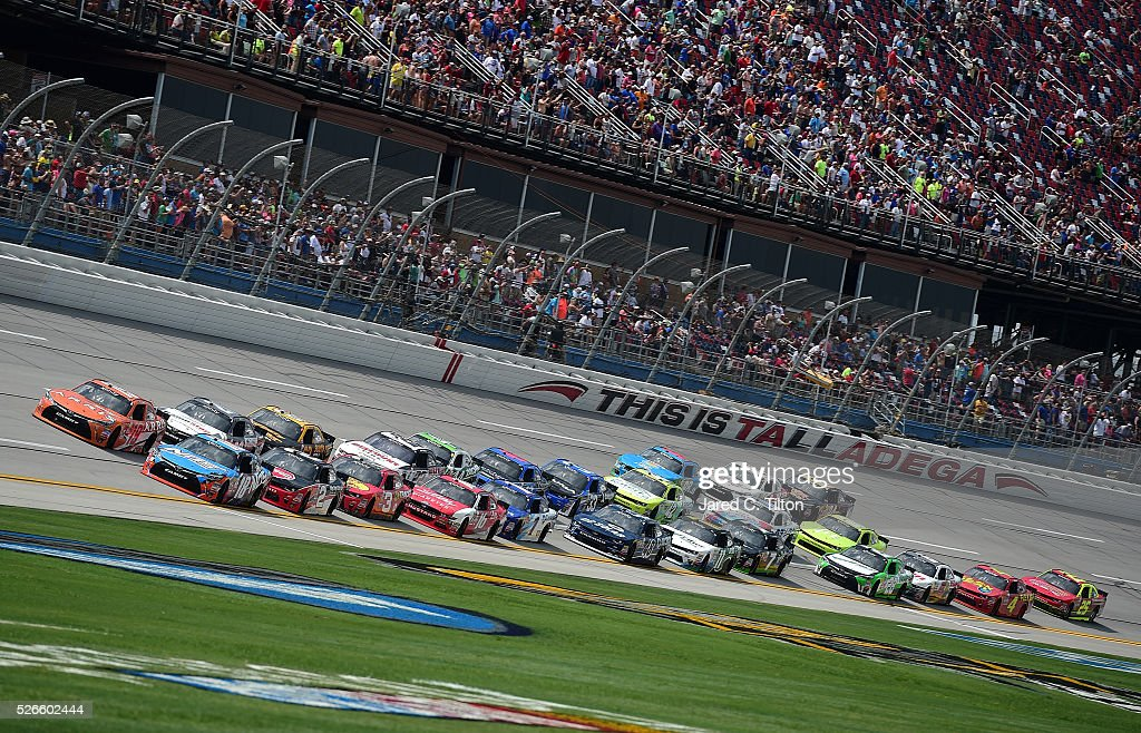 Daniel Suarez, driver of the #19 ARRIS Toyota, and Matt Tifft, driver of the #18 NOS Energy Drink Toyota, lead the field at the start of the NASCAR XFINITY Series Sparks Energy 300 at Talladega Superspeedway on April 30, 2016 in Talladega, Alabama.
