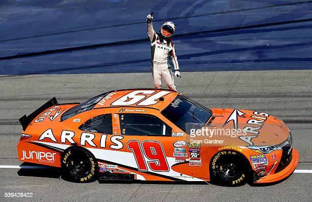 Daniel Suarez driver of the ARRIS Toyota celebrates after winning the NASCAR XFINITY Series Menards 250 at Michigan International Speedway on June 11...