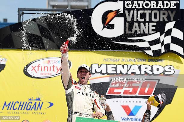 Daniel Suarez driver of the ARRIS Toyota celebrates in victory lane after winning the NASCAR XFINITY Series Menards 250 at Michigan International...